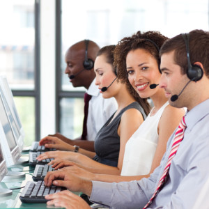 Ethnic businesswoman working in a call center with her colleagues