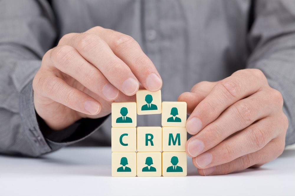 CRM (customer relationship management) concept. Businessman add new customer in database.