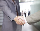 businesspeople shaking hands.