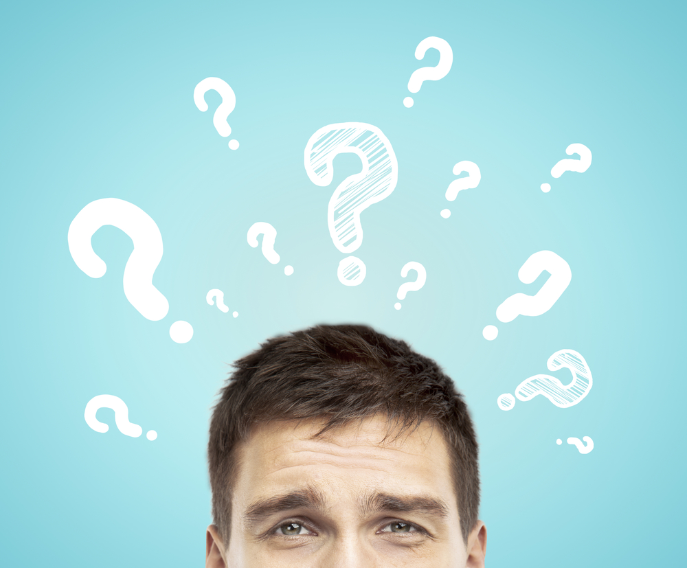 businessman with question mark  on a blue background